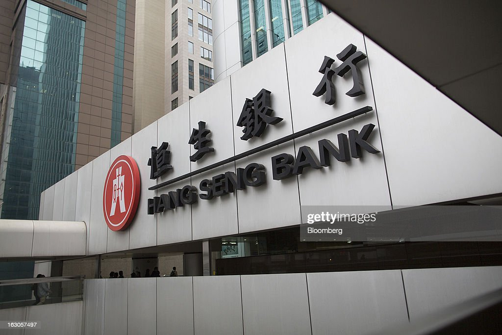 The Hang Seng Bank Ltd. logo is displayed outside the bank's headquarters in Hong Kong, China, on Saturday, March 2, 2013. Hang Seng Bank is scheduled to release annual results on March 4. Photographer: Jerome Favre/Bloomberg via Getty Images