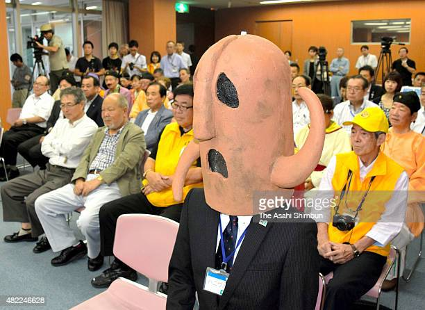 The 'HaniwaKacho' Sakai City's PR mascot and other members show their dejection after the city's Mozu Ancient Tombs was dropped from the domestic...