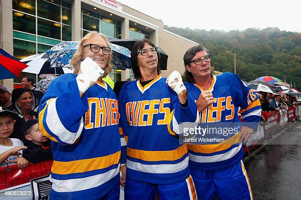 The Hanson Brothers Dave Hanson Steve Carlson and Jeff Carlson pose outside the Cambria County War Memorial Arena before the Pittsburgh Penguins and...