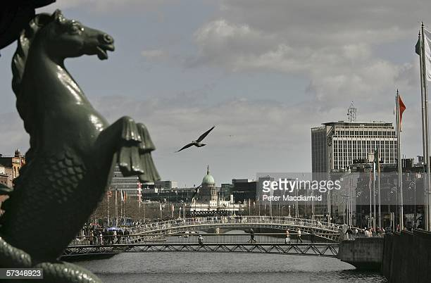 The Ha'Penny Bridge over the River Liffey on April 16 2006 in Dublin Ireland Modern Irish Defence forces are taking part in commerorations of the...