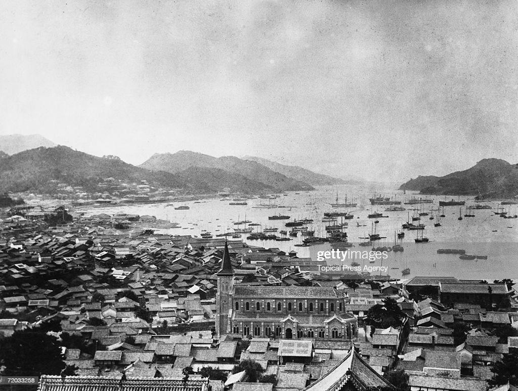 The harbour at Nagasaki Japan circa 1920 A Christian church can be seen in the foreground