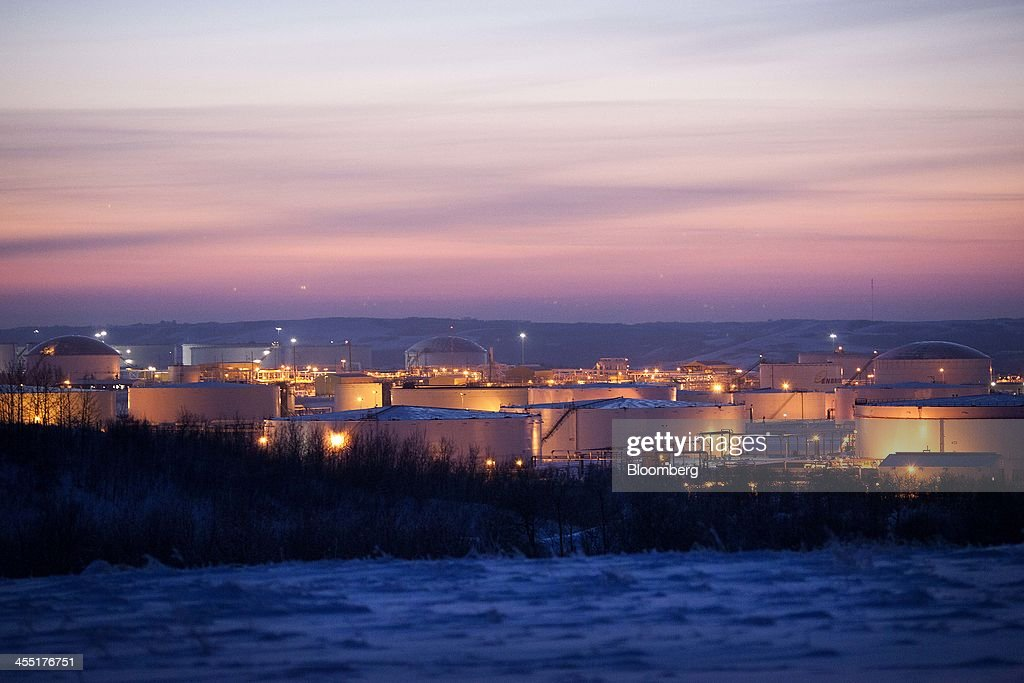 The Hardisty tank farm, which includes the TransCanada Corp. Hardisty Terminal 1, stands at dusk in Hardisty, Alberta, Canada, on Friday, Dec. 6, 2013. Canadian heavy crude reached its strongest level in more than two months on the spot market as a pipeline connection to the U.S. Gulf Coast began filling with crude ahead of its startup next month. Photographer: Brett Gundlock/Bloomberg via Getty Images