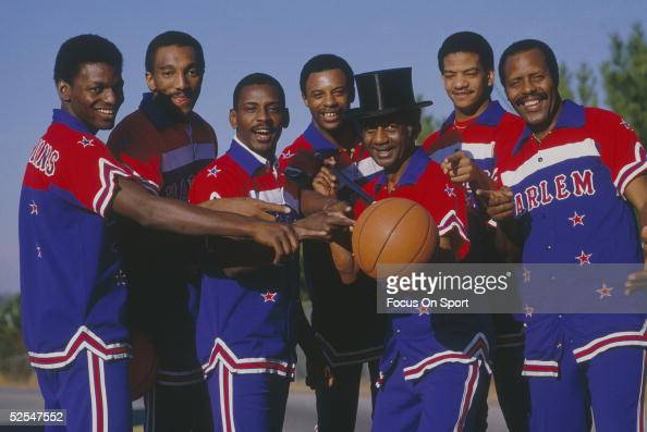 The Harlem Globetrotters pose for photos