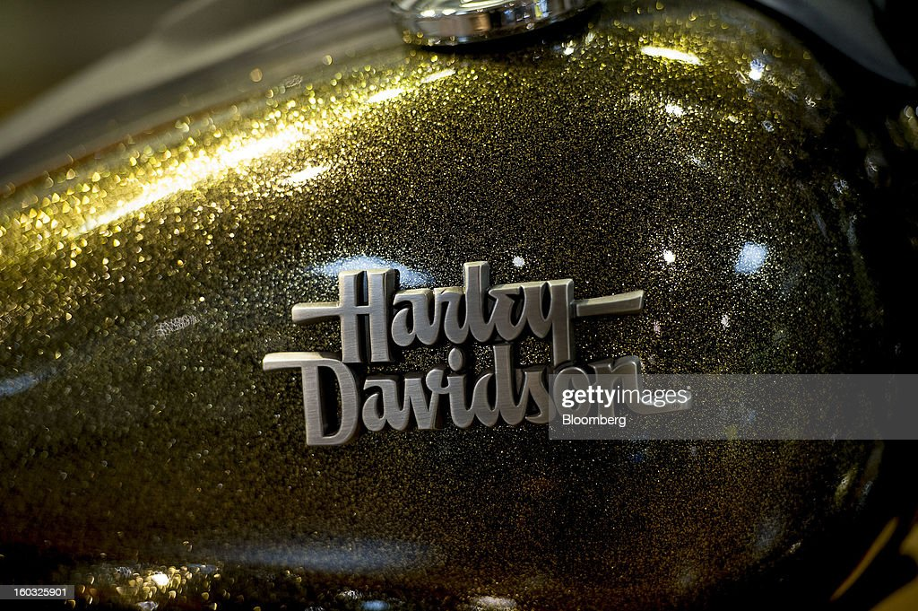 The Harley-Davidson Inc. logo is displayed on the gas tank of a motorcycle on the showroom floor at the Dudley Perkins Co. dealership in South San Francisco, California, U.S.,, on Monday, Jan. 28, 2013. Harley-Davidson reported fourth quarter revenue of $1.17 billion. Photographer: David Paul Morris/Bloomberg via Getty Images