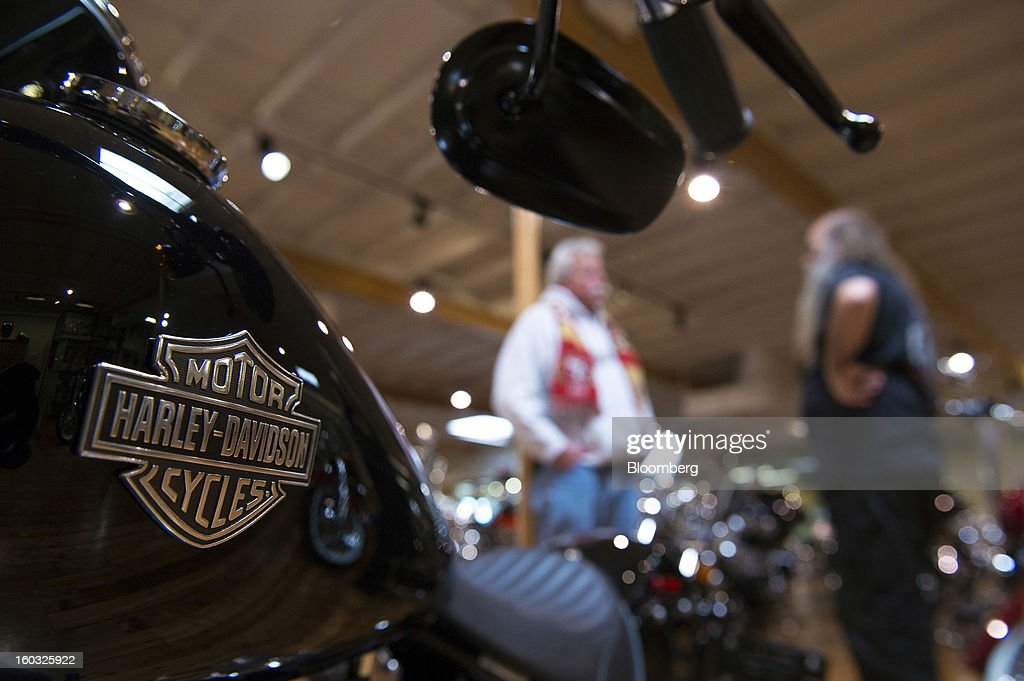 The Harley-Davidson Inc. logo is displayed on the gas tank of a motorcycle on the showroom floor at the Dudley Perkins Co. dealership in South San Francisco, California, U.S., on Monday, Jan. 28, 2013. Harley-Davidson reported fourth quarter revenue of $1.17 billion. Photographer: David Paul Morris/Bloomberg via Getty Images