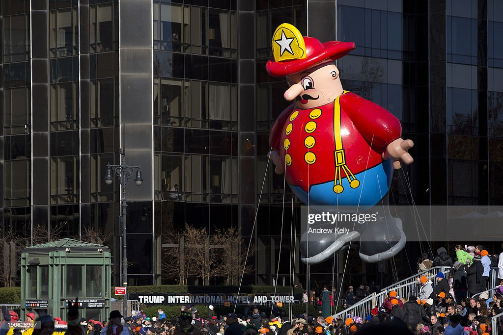 The Harold the Fireman balloon makes its way through Columbus Circle during the 86th Annual Macy's Thanksgiving Day Parade on November 22, 2012 in New York City. Macy's donated tickets and transportation to this year's Thanksgiving Day Parade to 5,000 people from neighborhoods hardest hit by Superstorm Sandy.