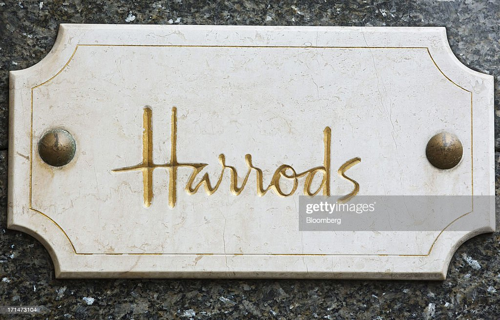 The Harrods logo is seen on a plaque outside the luxury department store in London, U.K., on Monday, June 24, 2013. Harrods, which has more than 1 million square feet (90,000 square meters) of selling space, isn't concerned about the outlook for spending on luxury goods, Harrods Managing Director Michael Ward said. Photographer: Jason Alden/Bloomberg via Getty Images