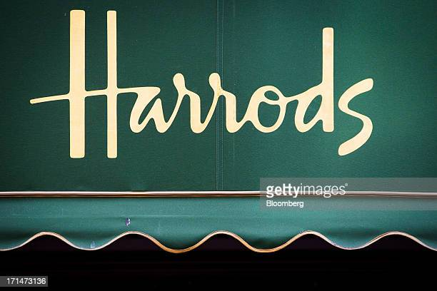 The Harrods logo is seen on the awning of the luxury department store in London UK on Monday June 24 2013 Harrods which has more than 1 million...