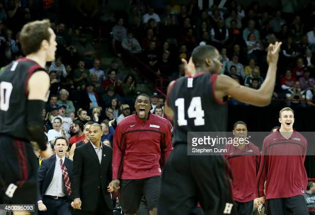 The Harvard Crimson celebrate as they tie the score in the second half against the Michigan State Spartans during the Third Round of the 2014 NCAA...
