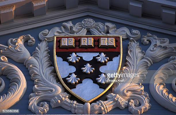 The Harvard seal detail on a pediment atop the Harvard Business School located in Boston one of the graduate schools of Harvard University and one of...