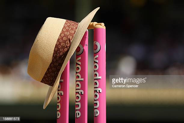 The hat of the late Tony Greig former England Test cricket captain turned commentator is seen resting on the stumps ahead of play during day one of...