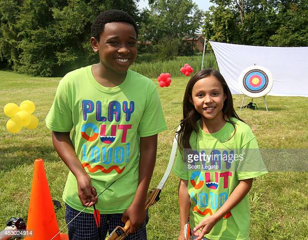 The Haunted Hathaways actors Curtis and Breanna attend Nickelodeon's Road to Worldwide Day of Play in Detroit at the Patton Rec Center with Healthy...
