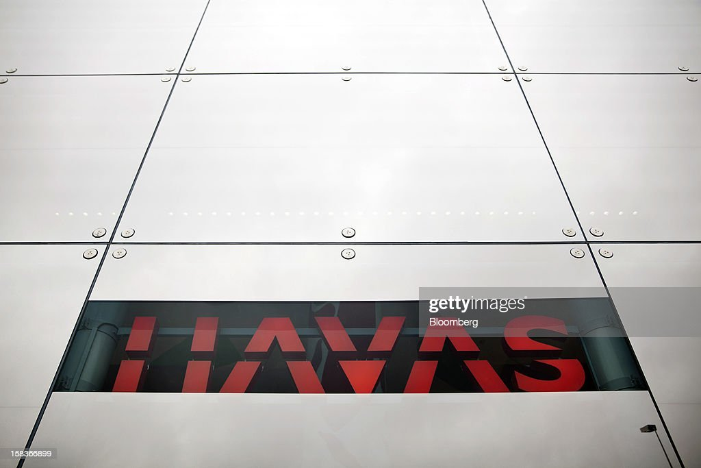 The Havas SA logo is seen displayed on the outside of their headquarters in Paris, France, on Friday, Dec. 14, 2012. Havas SA, the French advertising company which is known for memorable advertising campaigns, including the 2009 commercials for Evian water that featured babies on roller skates. Photographer: Balint Porneczi/Bloomberg via Getty Images