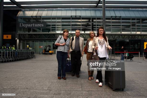 The Hawker family of Lindsay Ann Hawker who was murdered in Japan mother Julia father Bill sister Lisa and sister Louise arrive at Terminal 3 of...