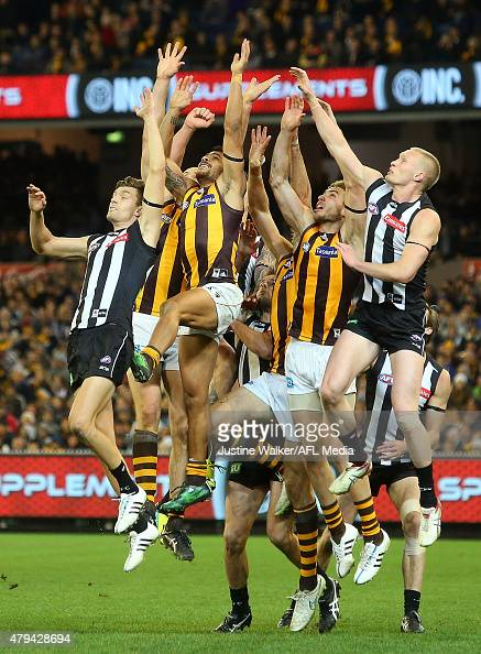 The Hawks and Collingwood players contest a mark during the 2015 AFL round 14 match between the Collingwood Magpies and the Hawthorn Hawks at the...