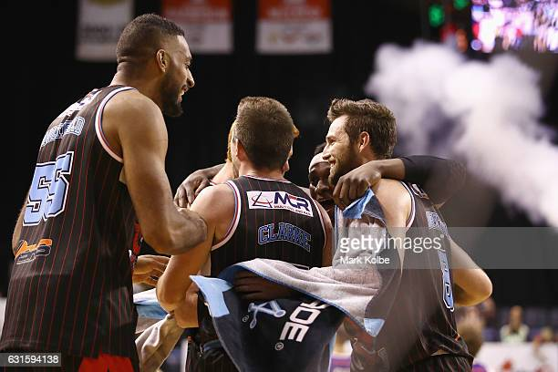 The Hawks celebrate victory during the round five NBL match between the Illawarra Hawks and the Brisbane Bullets at WIN Entertainment Centre on...