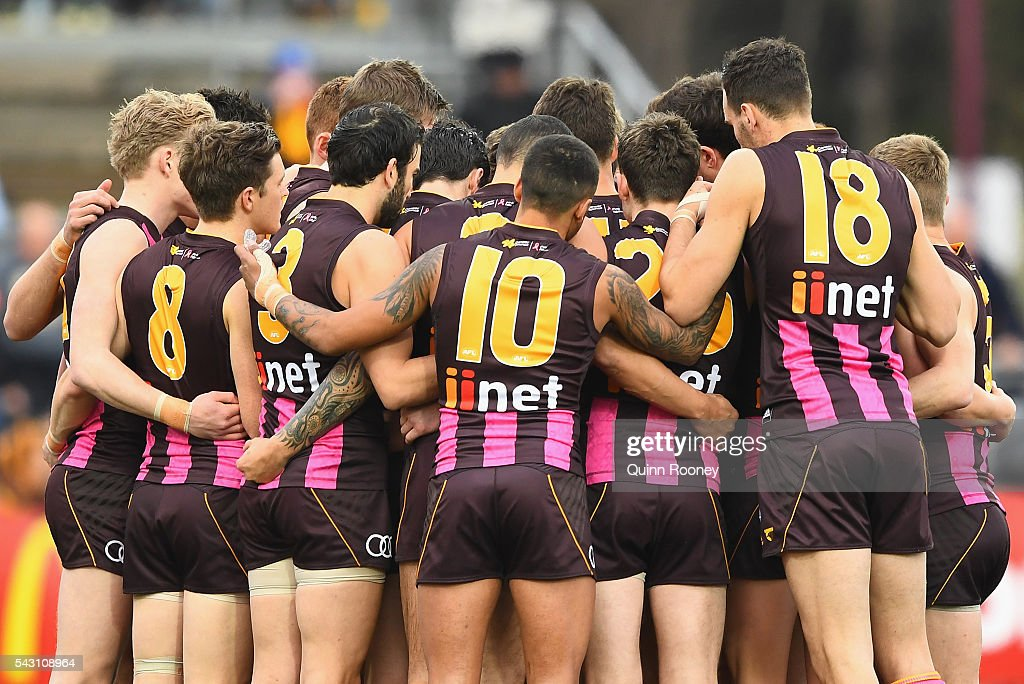 The Hawks huddle together during the round 14 AFL match between the Hawthorn Hawks and the Gold Coast Suns at Aurora Stadium on June 26, 2016 in Launceston, Australia.