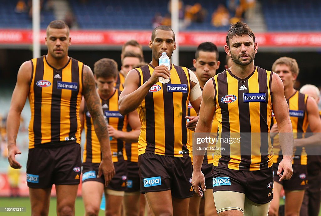 The Hawks look dejected as they leave the field after losing the round one AFL match between the Hawthorn Hawks and the Geelong Cats at the Melbourne Cricket Ground on April 1, 2013 in Melbourne, Australia.
