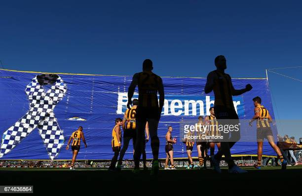 The Hawks run out for the round six AFL match between the Hawthorn Hawks and the St Kilda Saints at University of Tasmania Stadium on April 29 2017...