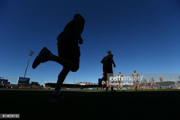 The Hawks run out for their warm up session before the round six AFL match between the Hawthorn Hawks and the St Kilda Saints at University of...