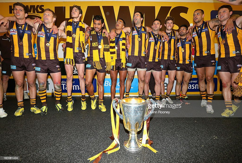 The Hawks sing the song in the rooms after winning the 2013 AFL Grand Final match between the Hawthorn Hawks and the Fremantle Dockers at Melbourne Cricket Ground on September 28, 2013 in Melbourne, Australia.