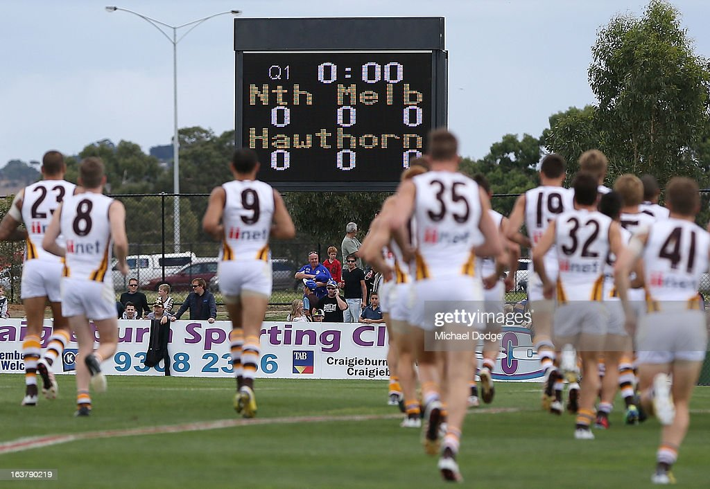 The Hawthorn Hawks run onto the ground in front of the suburban scoreboard during the AFL NAB Cup match between the North Melbourne Kangaroos and the Hawthorn Hawks at Highgate Recreational Reserve on March 16, 2013 in Craigieburn, Australia.