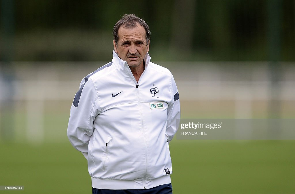 The head coach of the French women's national football team Bruno Bini watches his players during a training session on June 20, 2013 in Clairefontaine-en-Yvelines, outside Paris, ahead of the July 10 to 28 European Championship in Sweden.