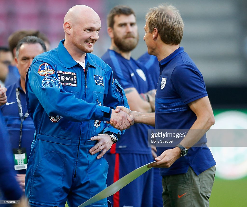 The head coach of the USA, Juergen Klinsmann (R) shake hands with astronaut <a gi-track='captionPersonalityLinkClicked' href=/galleries/search?phrase=Alexander+Gerst&family=editorial&specificpeople=5862799 ng-click='$event.stopPropagation()'>Alexander Gerst</a> prior to the International Friendly match between Germany and USA at RheinEnergieStadion on June 10, 2015 in Cologne, Germany.