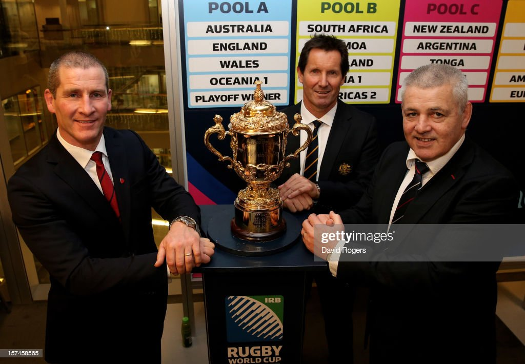 The head coaches of the pool A teams Stuart Lancaster Robbie Deans and Warren Gatland pose with the Webb Ellis trophy during the media session...