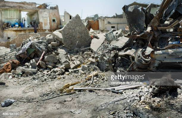 The head of a female suicide bomber watches over the remains of Al Nuri mosque in Mosul's Old City