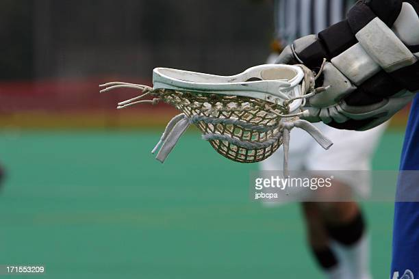 The head of a lacrosse being held
