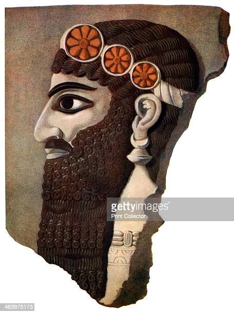 The head of an Assyrian priest or winged divinity 19331934 A print from Wonders of the Past Volume I 19331934