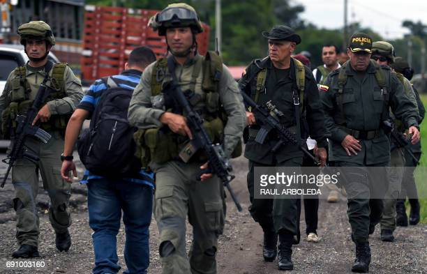 The head of Colombia's antinarcotics police Jose Mendoza takes part in a patrol to hand out pamphlets offering rewards for information leading to the...