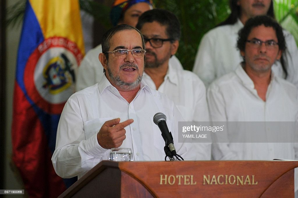 The head of Colombia's FARC leftist guerrilla Timoleon Jimenez aka 'Timochenko' speaks during a press conference with other members of his delegation...