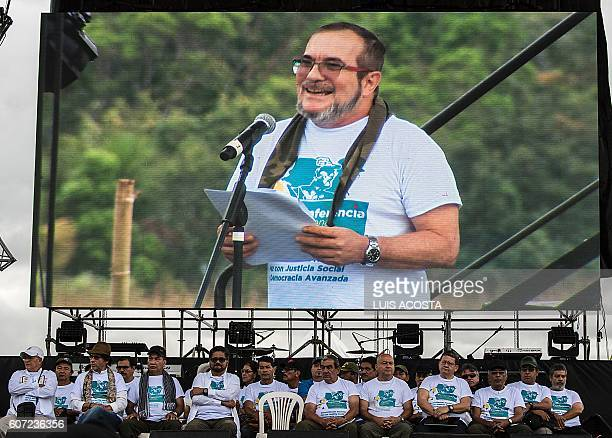 The head of Colombia's Revolutionary Armed Forces of Colombia leftist guerrilla Timoleon Jimenez aka 'Timochenko' speaks as members of the FARC...
