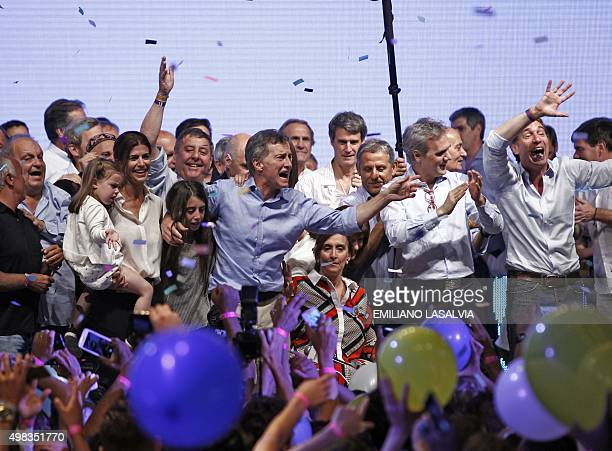 The Head of Government of the Autonomous City of Buenos Aires and candidate for the Cambiemos party Mauricio Macri celebrates with his running mate...