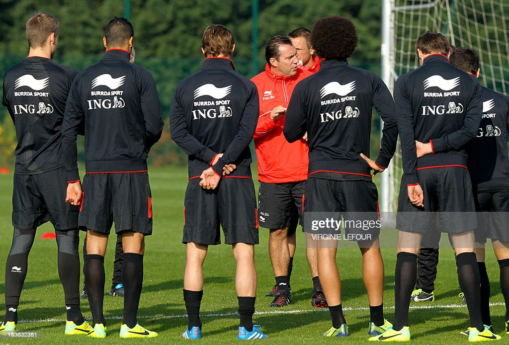 The head of the Belgian national football team Marc Wilmots (background C) speaks to players during a training session of the Red Devils in Neerpede, Brussels, on October 8, 2013. The Red Devils will play a qualification game in Croatia for the 2014 FIFA World Cup on October 11.