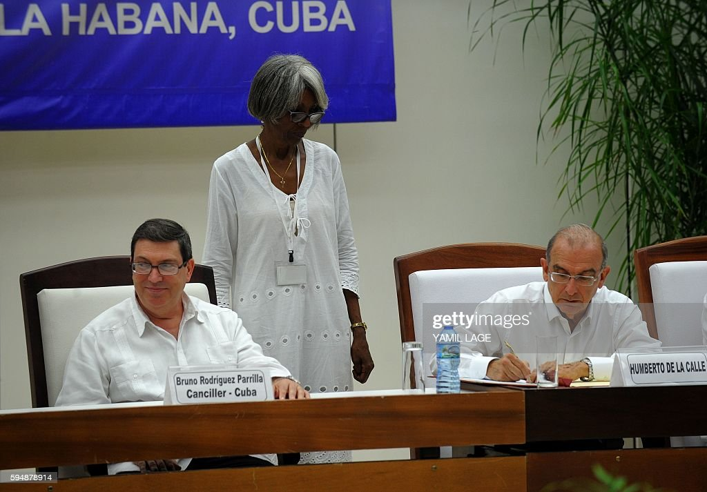 The head of the Colombian government delegation for peace talks Humberto de la Calle signs the agreement at the conclusion of the peace talks with...