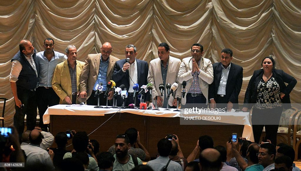 The head of the Egyptian journalists' union, Yahiya Kallash (C) speaks next to members of the association during an emergency general assembly on May 4, 2016, at their headquarters in Cairo. Egyptian police stormed the headquarters of the journalists' association in central Cairo on May 1, 2016 and arrested two journalists, Amr Badr and Mahmud el-Sakka, for incitement to protest. DESOUKI