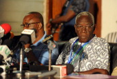 The head of the electoral commission Kwadwo AfariGyan announces on December 9 2012 results of the December 78 presidential election in Accra Ghanaian...