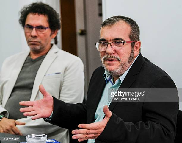 The head of the FARC guerrilla Timoleon Jimenez aka Timochenko gestures next to FARC commander Pastor Alape during a press conference in Bogota on...