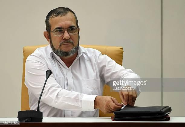 The head of the FARC guerrilla Timoleon Jimenez aka Timochenko speaks during a meeting with Colombian President Juan Manuel Santos in Havana on...