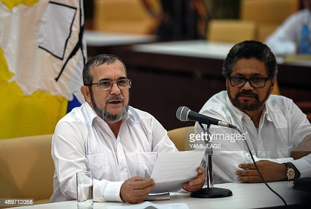 The head of the FARC guerrilla Timoleon Jimenez aka Timochenko speaks next to FARC Commander Ivan Marquez during a press conference after a meeting...