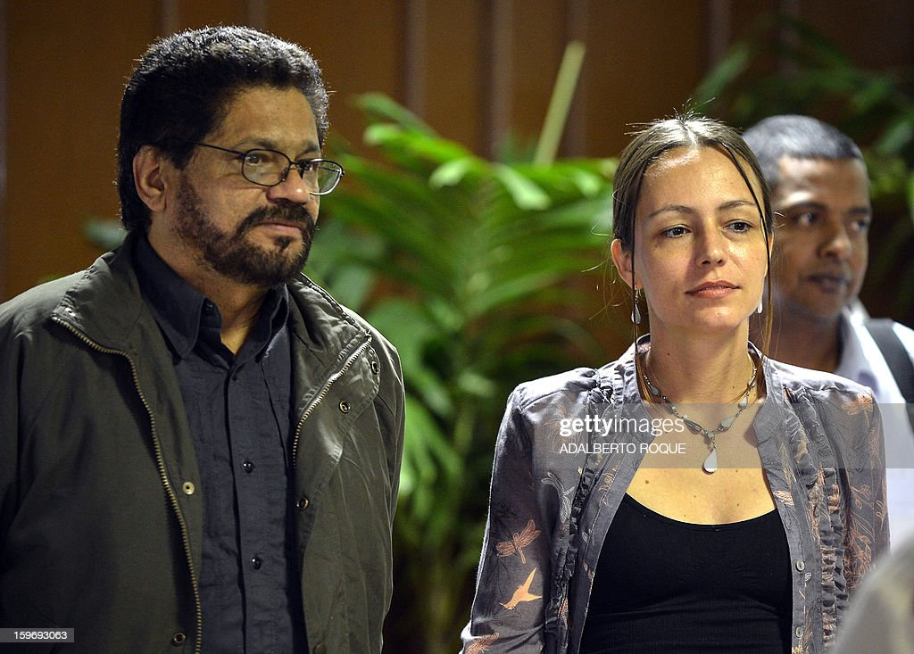 The head of the FARC-EP leftist guerrilla, Commander of the Ivan Marquez (L) and Dutch FARC fighter Tanja Nijmeijer (R) arrive at Convention Palace in Havana to take part in the peace talks with the Colombian government, on January 18, 2013.