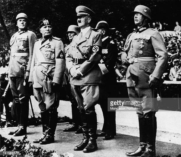 The head of the Fascist government Mussolini on the VIP standing among Adolf Hitler and some German officers The Italian dictator is on a state visit...