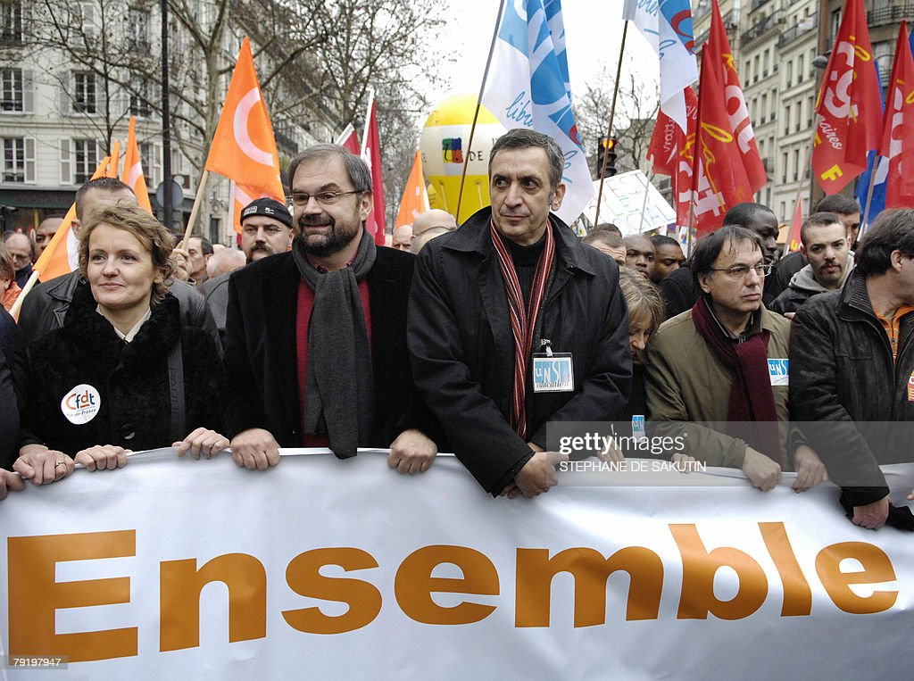 The head of the French CFDT workers union Francois Chereque (2dL) and head of Unsa-Education Patrick Gonthier (3dR) march during a demonstration with teachers and other public service employees to protest against jobs cuts and low wages, 24 January 2008 in Paris. Seven of the eight unions representing France's 5.2 million state employees called for the one-day strike and protest marches in Paris and other cities.