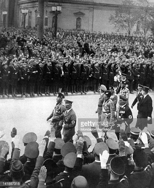 The head of the government of the kingdom of Italy Benito Mussolini and the chancellor of the Third Reich Adolf Hitler reviewing Nazi formations in...