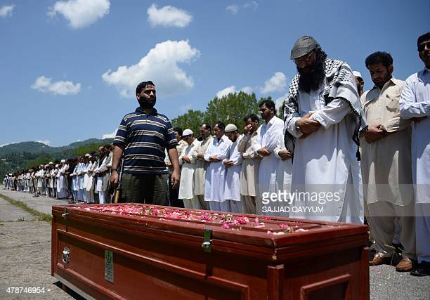 The head of the Kashmiri militant group Hizbul Mujahideen Syed Salahuddin leads prayers for an alleged Pakistani militant was killed in...
