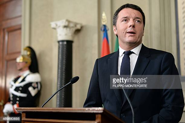The head of the leftist Democratic Party Matteo Renzi speaks to reporters at Quirinale Palace in Rome on February 17 after being nominated Italy's...