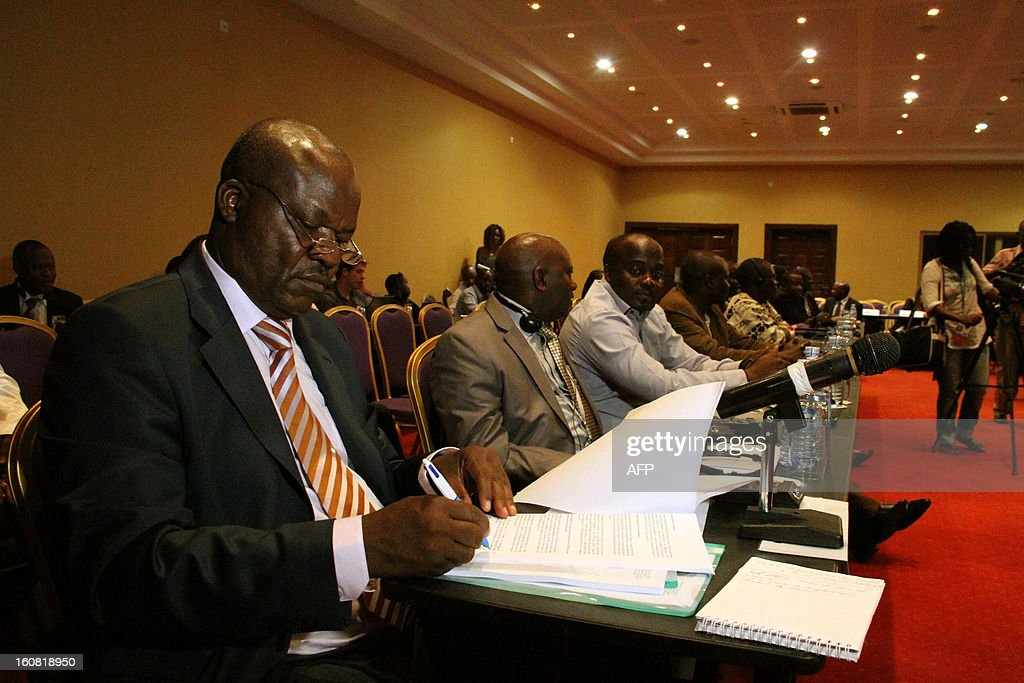 The head of the M23 Congolese rebels, Roger Lumbala, signs documents on February 6, 2013 before a press briefing in Kampala. The government of the Democratic Republic of Congo and M23 rebels holding peace talks in Kampala on February 6 finalized a review of an earlier failed peace agreement, the first of four stages toward reaching a peace deal. M23 rebels were persuaded to withdraw from the key eastern city of Goma after a 12-day occupation, they still control large areas of territory just outside the strategic mining hub. The negotiations are the latest in several bids to end a long-running conflict that has forced hundreds of thousands of people in eastern DR Congo from their homes. KASAMANI